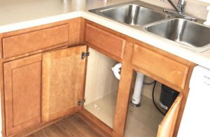 checking for-mold-behind-kitchen-wooden-cabinets